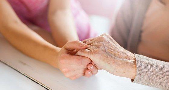 holding family member's hands in comfort